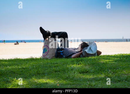 Man relaxing by the Beach in California - Stock Photo