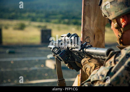 A U.S. Marine with Black Sea Rotational Force 18.1 conducts a tactical reload while executing an advanced portion of a Combat Marksmanship Program range during Exercise Platinum Lion 18 at Novo Selo Training Area, Bulgaria, Aug. 5, 2018. Platinum Lion is an annual field training exercise that reinforces relationships in a joint training environment, builds understanding of partner nation tactics, techniques and procedures, and increases interoperability with Allied and partner forces.  (U.S. Marine Corps photo by Cpl. Alexander Sturdivant/Released) - Stock Photo