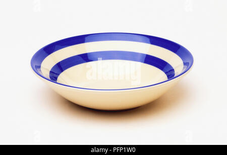 Blue and white striped bowl - Stock Photo