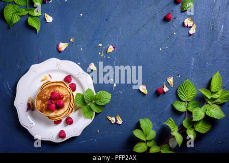 Stack of pancakes with fresh raspberries, jam on white plate. Table top view. Healthy breakfast food. - Stock Photo