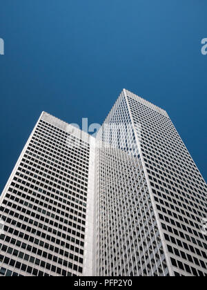 Abstract and Complex Blue Skyscraper Structure Downtown in Montreal with Sky in Background - Stock Photo