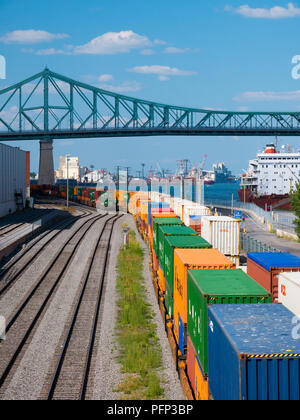 Montreal, Canada - august 19, 2018: View of old port area with train and ship in downtown of Montreal. - Stock Photo