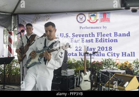 KOTA KINABALU, MALAYSIA (May 22, 2018) Musician 3rd Class Victor Martinez (front) and Musician 2nd Class Joshua Haney of the U.S. 7th Fleet Band perform at City Halll in Kota Kinabalu, Malaysia. The band is supporting a U.S. 7th Fleet theater security cooperation mission and will be traveling to several Indo-Pacific countries in the coming weeks. - Stock Photo
