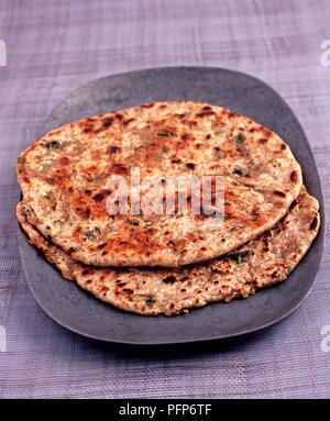 Tawa Mooli Paratha, spicy Indian paratha flatbread stuffed with daikon radish - Stock Photo
