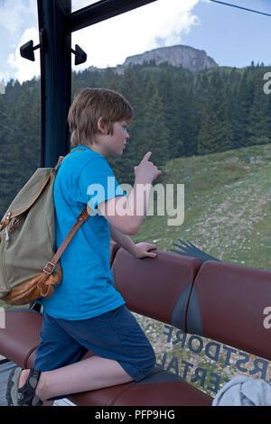 boy in the cable car, Hoher Ifen near Hirschegg, little Walser valley, Austria - Stock Photo