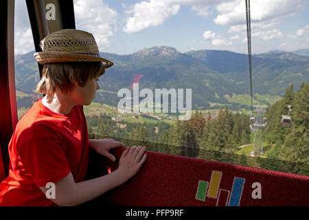 boy in Kanzelwand cable car, Riezlern, little Walser valley, Austria - Stock Photo