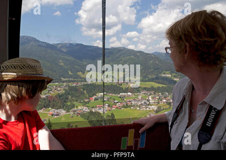 mother and son in Kanzelwand cable car, Riezlern, little Walser valley, Austria - Stock Photo