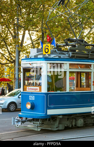 Zurich, Switzerland - September 27, 2017: an old time tram passing along a street in the city of Zurich. Trams have been a consistent part of Zurich's - Stock Photo