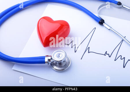 Medical stethoscope and red heart with cardiogram isolated on white. medical healthcare concept - Stock Photo