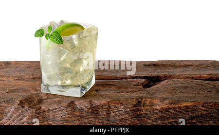 Vodka lime, gimlet or gin tonic with ice in glass on white background including clipping path - Stock Photo