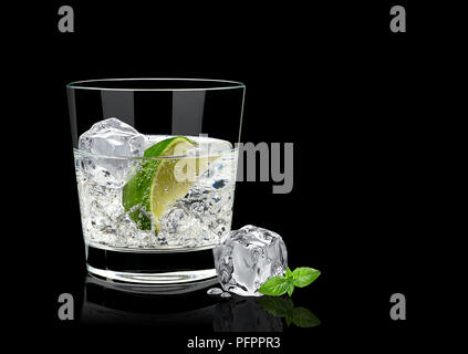 Gin tonic or vodka lime and basil isolated on black background - Stock Photo