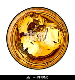 Whiskey with ice in glass from top on white background including clipping path - Stock Photo