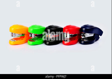 Staplers of different colors isolated on a white background. - Stock Photo