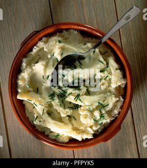Garlic Creamed Potatoes, served in round dish, garnished with chopped chives,Garlic Creamed Potatoes, served in round dish, garnished with chopped chives - Stock Photo