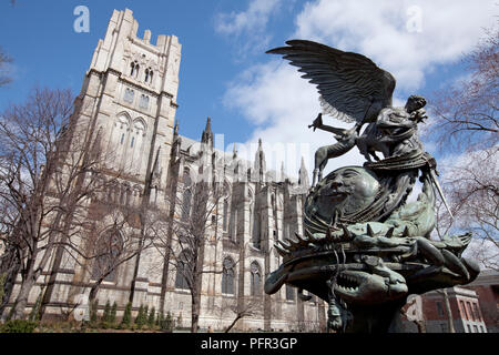 USA, New York, New York City, Manhattan, Cathedral of St. John the Divine with Peace Fountain in forefront set against blue sky - Stock Photo