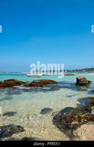 Sri Lanka, Southern Province, Galle, Unawatuna, boats moored in bay - Stock Photo