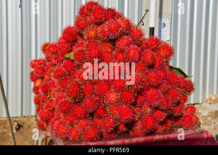 Sri Lanka, Western Province, Colombo, Ja-Ela, heap of rambutan fruit - Stock Photo