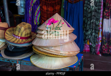 Colourful Thai hats on sale on market stall in Bangkok Thailand - Stock Photo