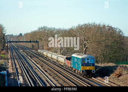 A class 73 electro-diesel locomotive number 73136 'Perseverance' working a weekend engineers train at Potbridge on the 16th December 2006. - Stock Photo