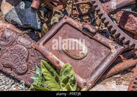 Rusty vintage doors and large rusty vintage gear - Stock Photo