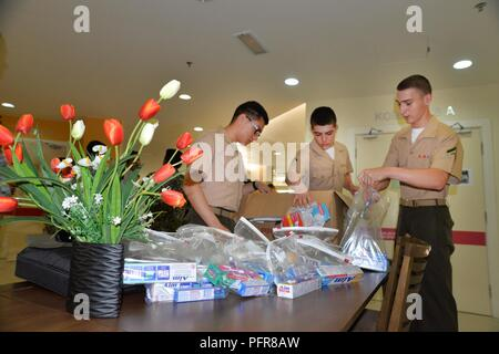 KOTA KINABALU, Malaysia (May 22, 2018) Marines assigned to Fleet Anti-terrorism Security Team Pacific (FASTPAC) put together care packages for patients during a visit to Queens Memorial Hospital as part of a community relations project. The Marines and Sailors are currently embarked on USNS Millinocket (T-EPF 3) as part of a U.S. 7th Fleet theater security cooperation patrol and will visit several countries in the Indo-Pacific in the coming weeks. - Stock Photo