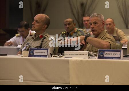 U.S. Marine Corps Lt. Gen. Brian Beaudreault, deputy commandant, Plans, Policies, and Operations, Headquarters Marine Corps, asks a question during the Pacific Amphibious Leaders Symposium (PALS) 2018 in Honolulu, Hawaii, May 22, 2018. PALS brings together senior leaders of allied and partner militaries with significant interest in the security and stability of the Indo-Pacific region to discuss key aspects of maritime/amphibious operations, capability development, crisis response, and interoperability. - Stock Photo