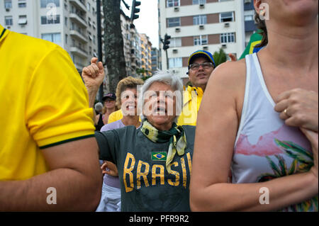 Rio de Janeiro – December 4, 2016: Demonstrators march along Copacabana Beach to denounce political corruption in Brazil - Stock Photo