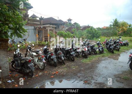 Motorbikes parked in Ubud, Bali, Indonesia. - Stock Photo