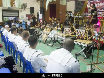 KOTA KINABALU, MALAYSIA (May 25, 2018) The SMK Tamparuli bamboo orchestra performs for members of the U.S. 7th Fleet Band at SMK Tamparuli High School in Kota Kinabalu, Malaysia. The band is supporting a U.S. 7th Fleet theater security cooperation mission and will be traveling to several Indo-Pacific countries in the coming weeks. - Stock Photo