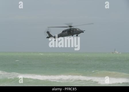 HH-60G Pave Hawks from the 920th Rescue Wing at Patrick Air Force Base in Cocoa Beach, Florida perform a combat search and rescue demonstration at Miami Beach, Florida on May 26th, 2018 during the 2nd annual National Salute to America's Heroes Air and Sea Show. The two-day event showcases military fighter jets and other aircraft and equipment from all branches of the United States military in observance of Memorial Day. - Stock Photo