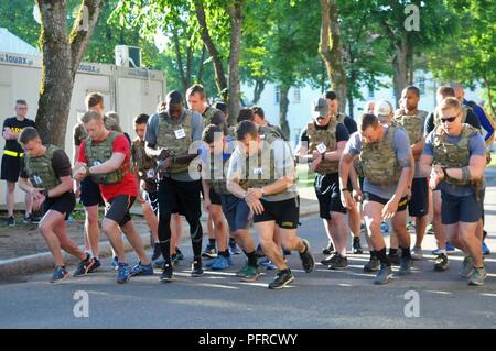 Battle Group Poland Soldiers remember Memorial Day by competing in the Murph Challenge in honor of the fallen who gave the ultimate sacrifice in defense of the nation at Bemowo Piskie Training Area, on May 28, 2018. These Soldiers are part of the unique, multinational battle group comprised of U.S., U.K., Croatian and Romanian soldiers who serve with the Polish 15th Mechanized Brigade as a deterrence force in northeast Poland in support of NATO's Enhanced Forward Presence. - Stock Photo