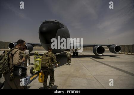 A U.S. Air Force KC-135 Stratotanker aircrew assigned to the 340th Expeditionary Air Refueling Squadron arrives at the flightline for a mission at Kandahar Airfield, Afghanistan, May 28, 2018. The KC-135 Stratotanker provides a tactical air refueling capability to U.S. and Coalition forces enabling them to stay in the air for longer periods of time while conducting combat air patrols. - Stock Photo