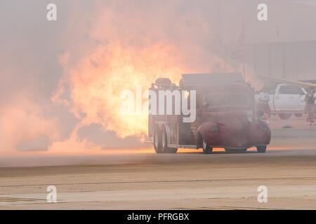 The Aftershock, a jet engine fire truck, drives through its own smoke at Cannon Air Force Base, N.M., May 26, 2018. The Aftershock hit speeds over 340 mph hours for the Cannon Air Force Base Air, Space, and Tech Fest. - Stock Photo