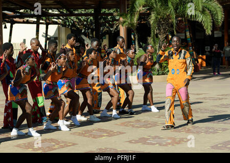Durban, KwaZulu-Natal, South Africa, adult man in costume leading group of street performers, traditional Zulu song and dance, singing troupe - Stock Photo
