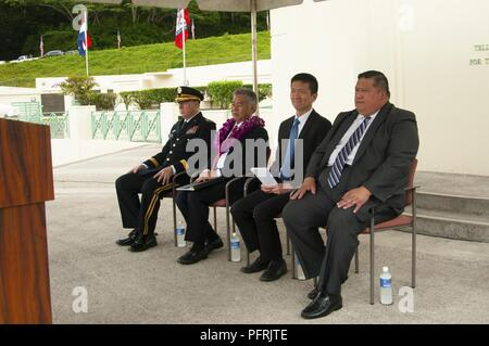 "U.S. Army Maj. Gen. Arthur J. Logan, Adjutant General for Hawaii National Guard, sits with Hawaii Governor David Y. Ige and distinguished guests at the 2018 Governor's Veterans Day Ceremony at the Hawaii State Veterans Cemetery in Kaneohe, Hawaii, May 28, 2018.  The theme for the ceremony was ""Honoring Our Fallen Warriors and Gold Star Families"" which included a parade of flags, presentation of floral leis and music from the 111th Hawaii Army National Guard Band. - Stock Photo"