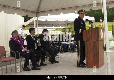 """U.S. Army Maj. Gen. Arthur J. Logan, Adjutant General for Hawaii National Guard, speaks during the 2018 Governor's Veterans Day Ceremony at the Hawaii State Veterans Cemetery in Kaneohe, Hawaii, May 28, 2018. The theme for the ceremony was """"Honoring Our Fallen Warriors and Gold Star Families"""" which included a parade of flags, presentation of floral leis and music from the 111th Hawaii Army National Guard Band. - Stock Photo"""