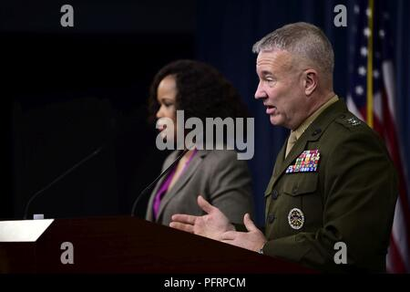 Dana White, the assistant to the secretary of defense for public affairs, and U.S. Marine Corps Lt. Gen. Kenneth F. McKenzie, the Joint Staff director, brief the press at the Pentagon in Washington, D.C., May 31, 2018. - Stock Photo