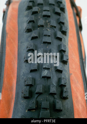 Mountain bike tyre with thick off-road tread - Stock Photo