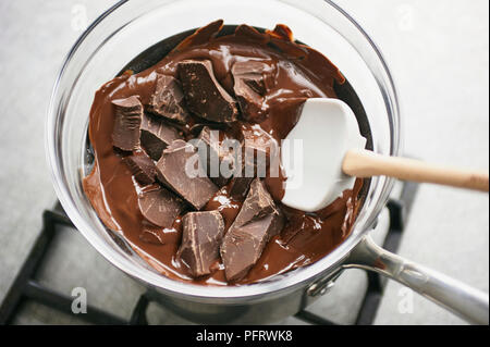 Tempering chocolate - Stock Photo
