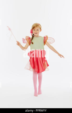 Young girl dressed as fairy in pink and green costume - Stock Photo