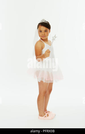 Young girl dressed in fairy princess costume with wand - Stock Photo