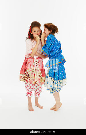 Two girls dressed as Cinderella's sisters in blue and pink fancy dress costume - Stock Photo