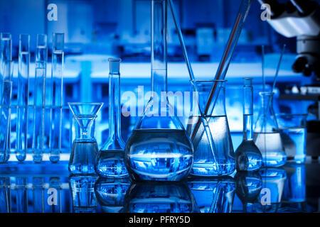 Science laboratory. Experiment with liquids. Laboratory glassware. - Stock Photo