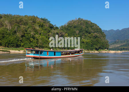 Boat on the Mekong river Laos - Stock Photo