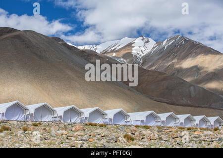 Tented tourist camp at Pangong Tso Lake in Ladakh, India. - Stock Photo