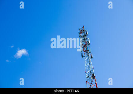Mobile phone Telecommunication Radio antenna Tower. Cell phone tower.phone base station with TV and wireless internet antennas.Copy space.Huge communication antenna tower and satellite dishes against blue sky. - Stock Photo
