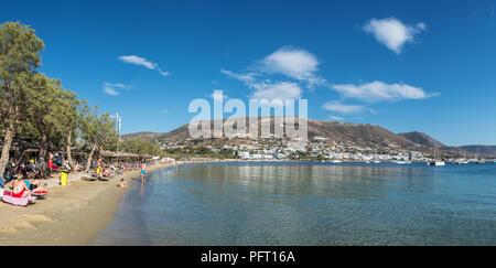 Paros, Greece - June 1, 2018: Sandy public beach in Parikia town on Paros island, Cyclades, Greece. - Stock Photo