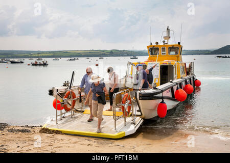 UK, Cornwall, Rock, harbour, passengers disembarking Camel River Ferry from Padstow - Stock Photo