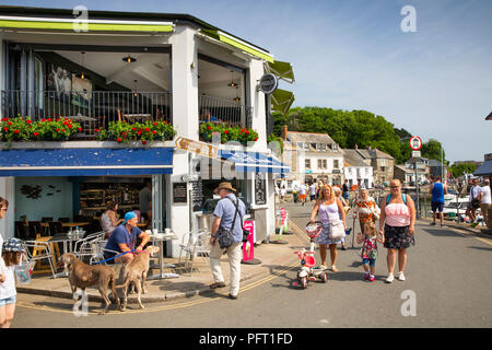 UK, Cornwall, Padstow, The Strand, visitors outside waterfront Fish and Chip shop - Stock Photo