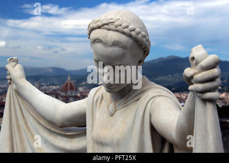 Female statue in San Miniato al Monte Cemetery, Florence, Italy. - Stock Photo
